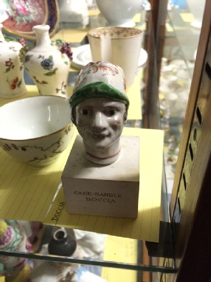 Cane handle as man's head wearing a Phrygian cap