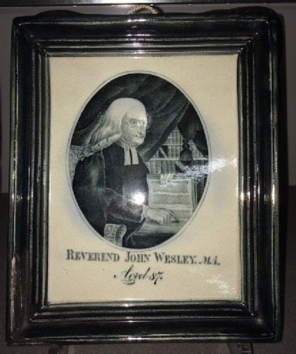 Plaque shaped as framed engraving of Rev John Wesley