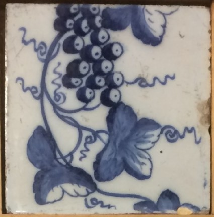 Tile with fruiting grape vine, detail