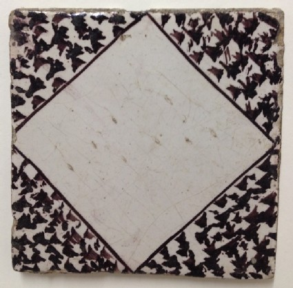 Tile with plain lozenge and marbled corners