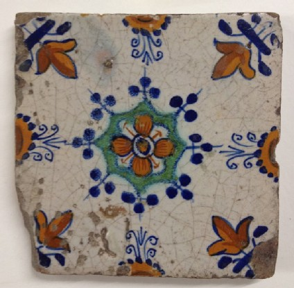 Tile with stylised floral centre