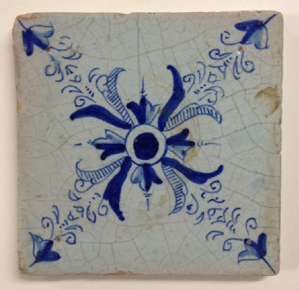 Tile with stylised flower pattern