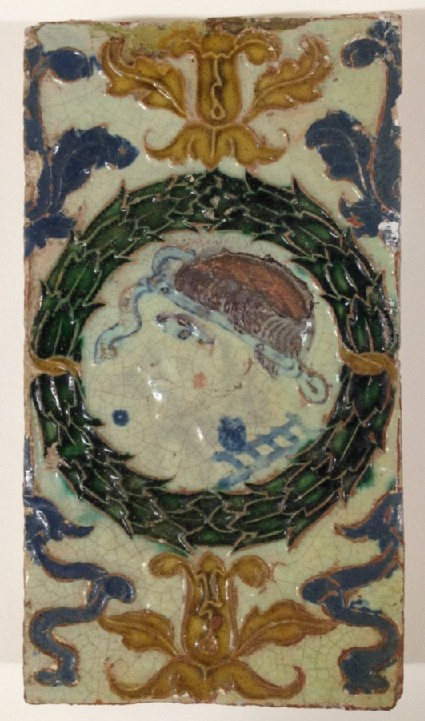 Rectangular ceiling tile with classical male profile within green garland