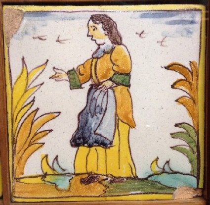Tile with woman in landscape