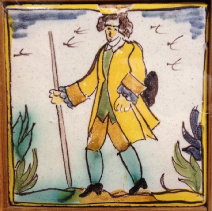 Tile with gentleman holding stick