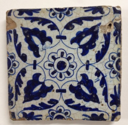 Tile with geometric palmettes and rosettes design