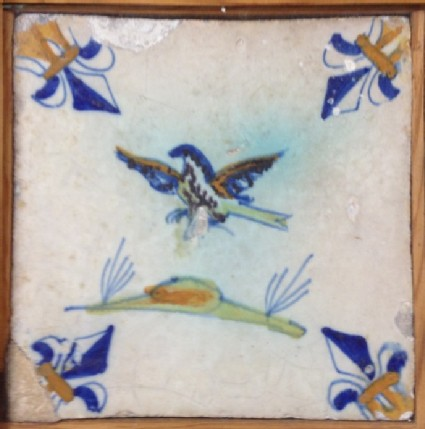 Tile with flying bird