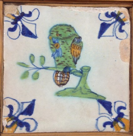 Tile with polychrome bird perched on branch