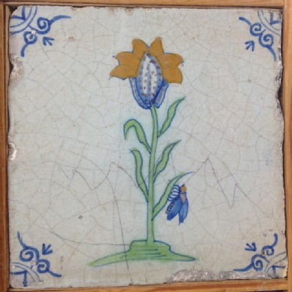 Tile with polychrome tulip-like flower with bee