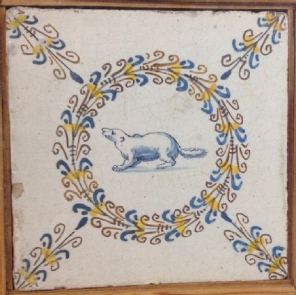 Tile with beaver within polychrome aigrette circle