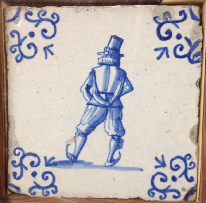 Tile with rear view of man skating