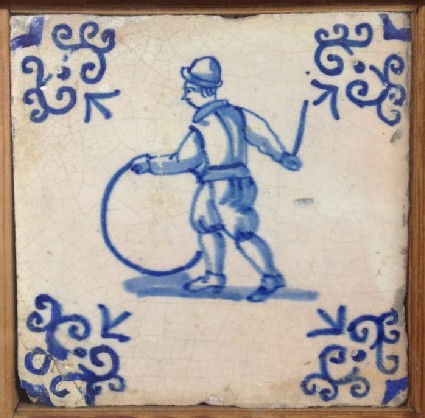 Tile with boy bowling hoop