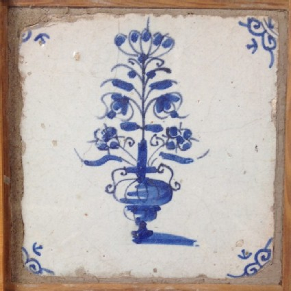 Tile with vase of tall flowers