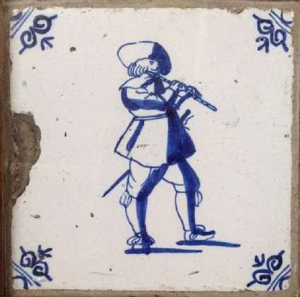 Tile with man playing the flute