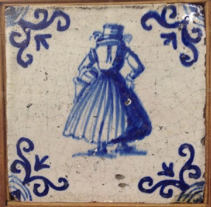 Tile with rear view of woman carrying basket