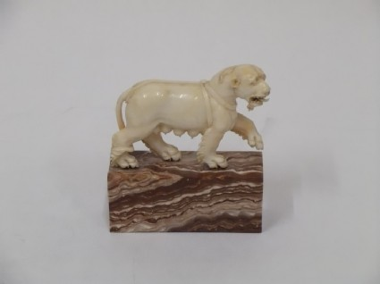 Figure of a lioness walking