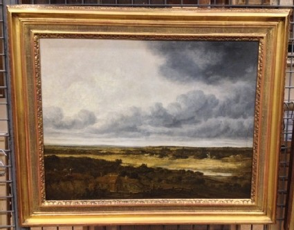 Landscape with Cottages and a stormy Sky