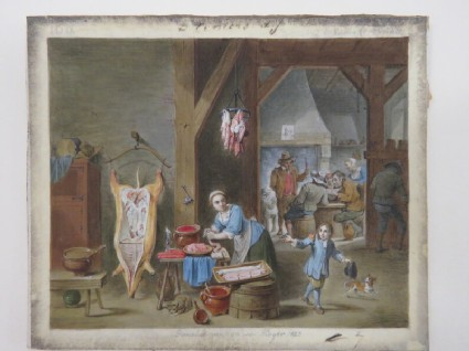 Interior of a kitchen with a woman preparing sausages