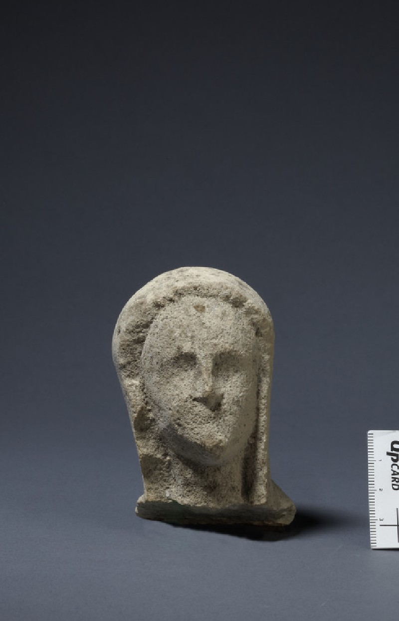 Limestone head of female votary, veiled, fragment of votive-statuette (AN1874.340)