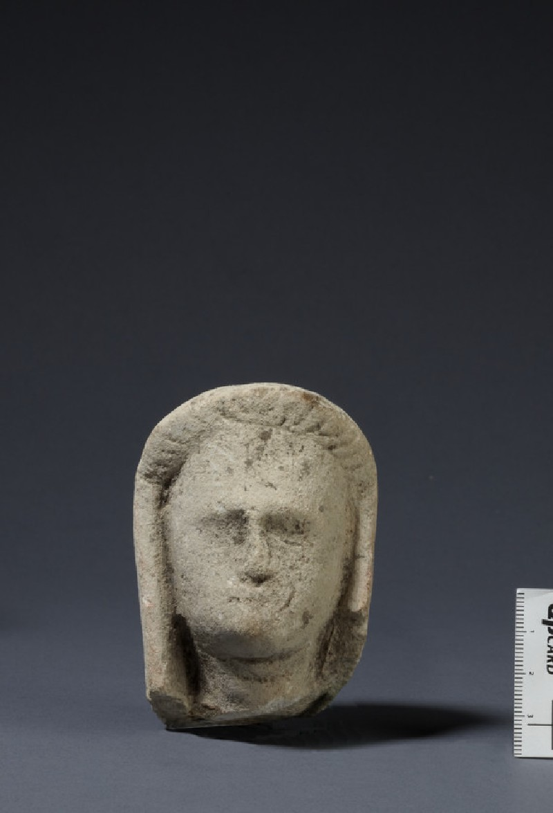 Limestone head of female votary, veiled, fragment of votive statuette (AN1874.341)