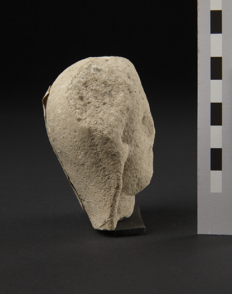 Limestone head of female votary, veiled, fragment of votive-statuette (AN1874.343)