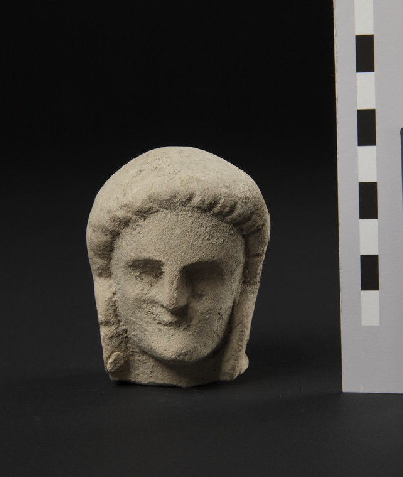 Limestone head of female votary, veiled, fragment of votive-statuette (AN1874.344)