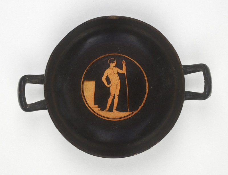 Attic red-figure pottery stemless cup depicting an athletics scene (AN1879.167)