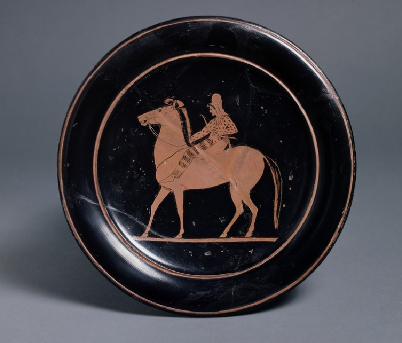 Attic red-figure pottery plate depicting a mounted archer in Persian dress