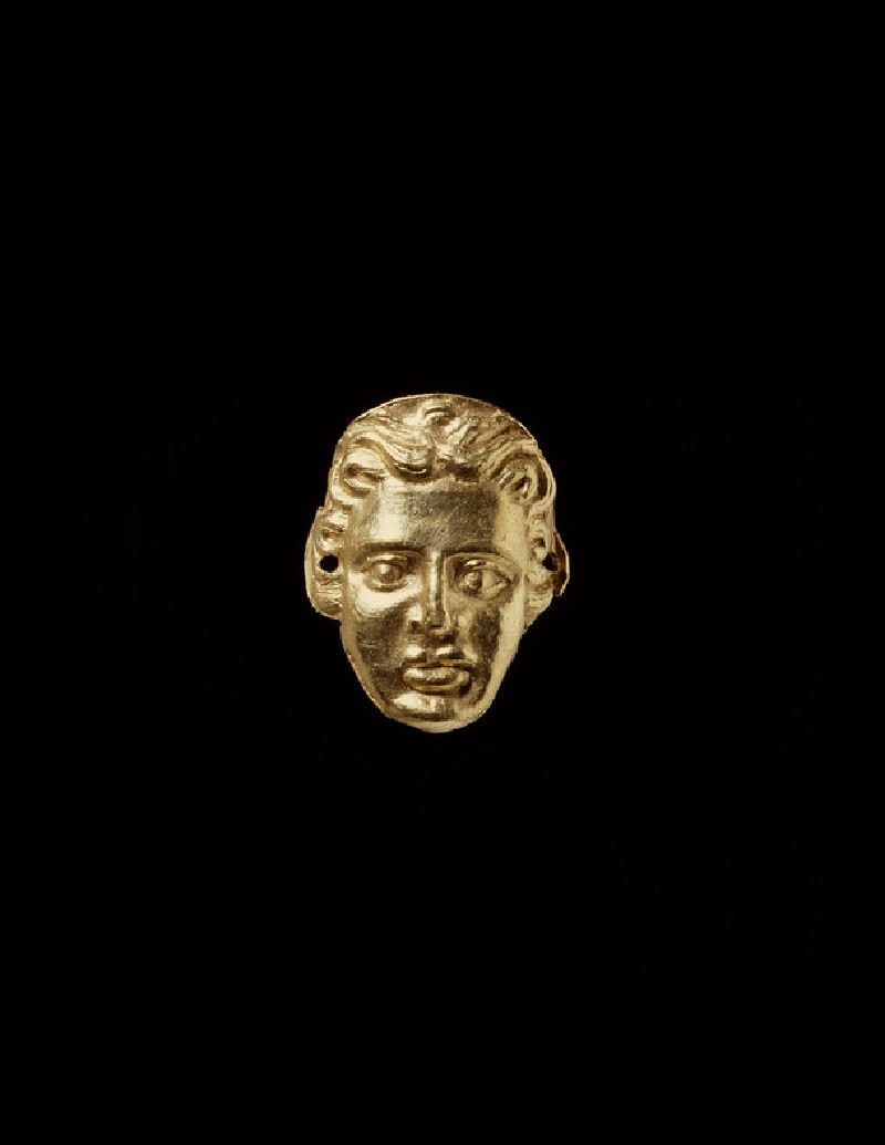 Gold applique in the form of a human face