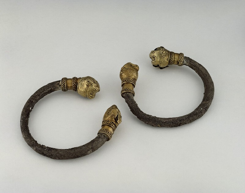 Pair of silver bracelets with electrum lion's head terminals (AN1885.503)