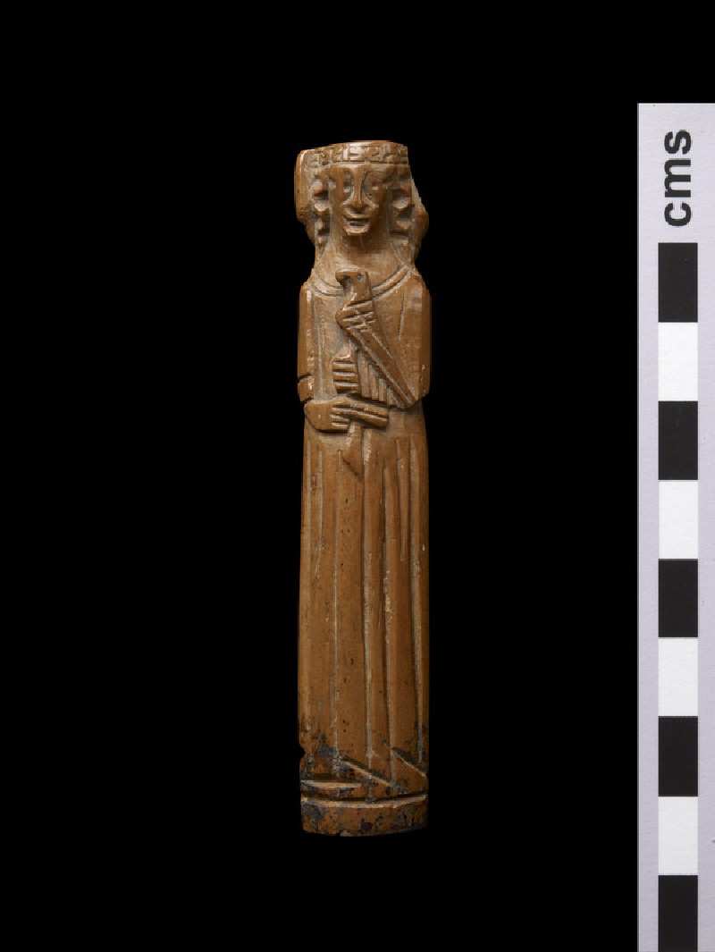 Knife handle carved in shape of a lady in dress holding a hawk