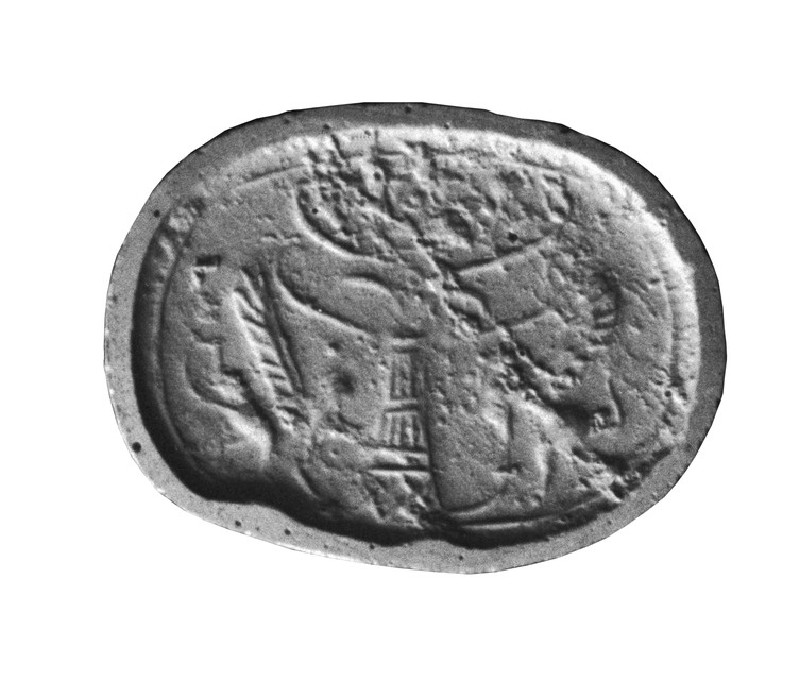 Scaraboid stamp seal, a griffin, disk on head, on either side of a stylized tree (AN1886.984)