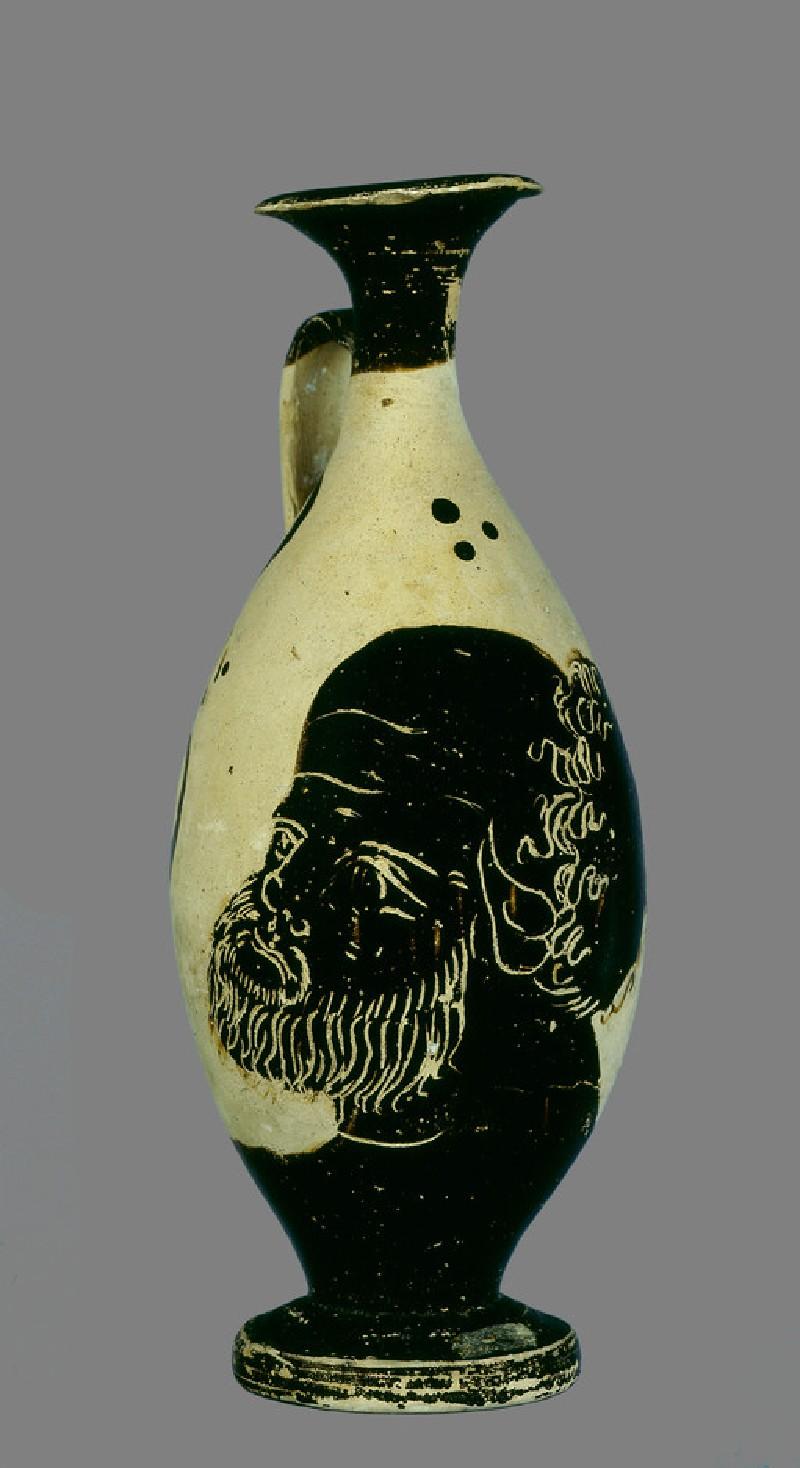 Black-figure pottery lekythos (oil-jar) with the head of Silenus (AN1891.322)