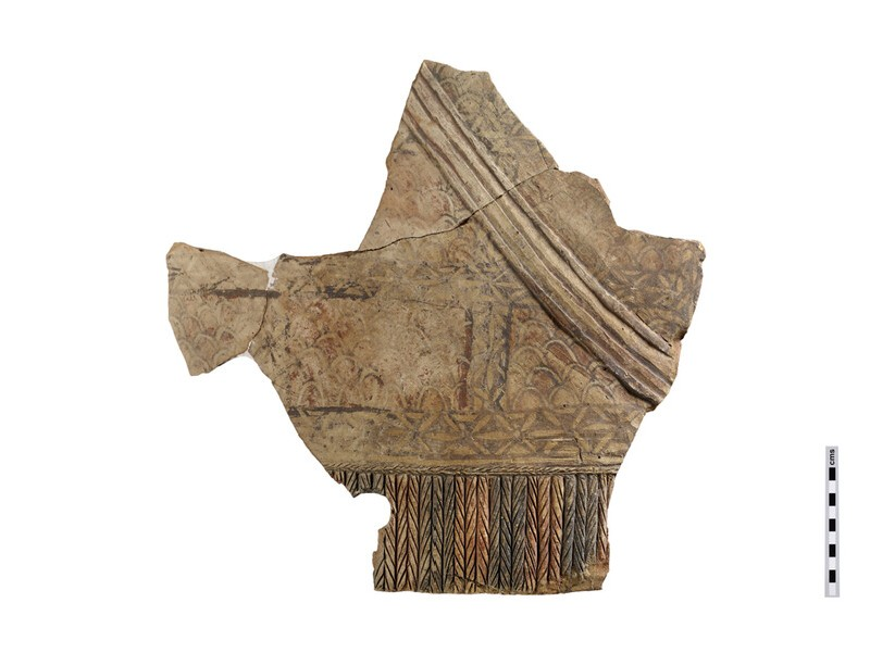 Fragment the front of the torse of large male terracotta votive figure, showing a cuirass and a diagonal swordband