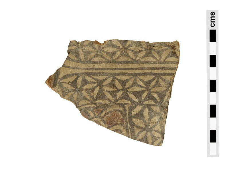 Fragment of large terracotta votive figure, cuirass or garment with star-pattern