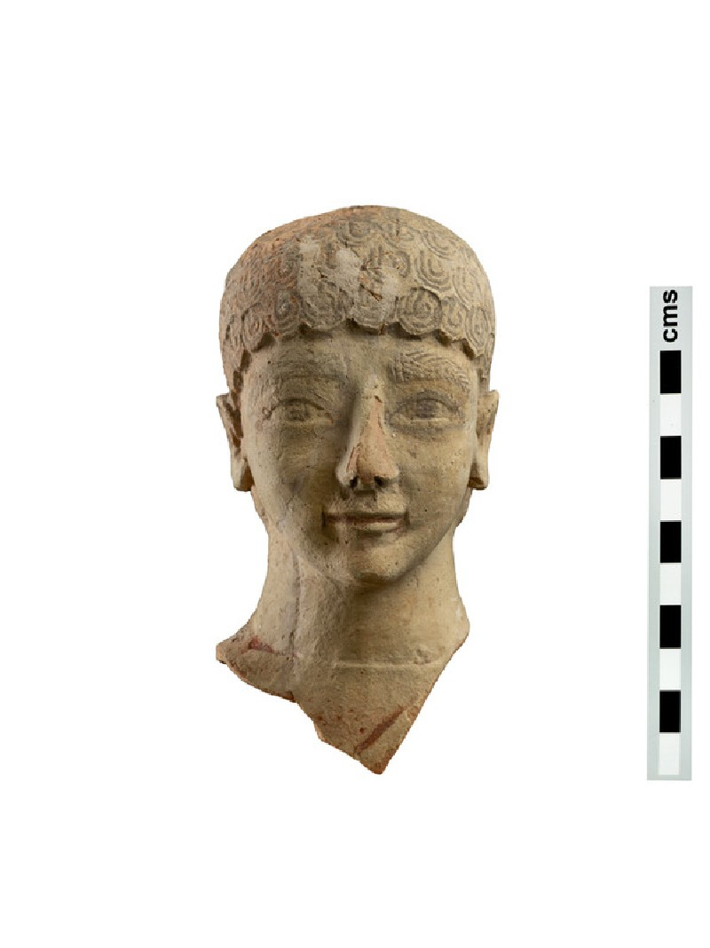 Head of terracotta votive figure of male youth with short curly hair (AN1891.475)