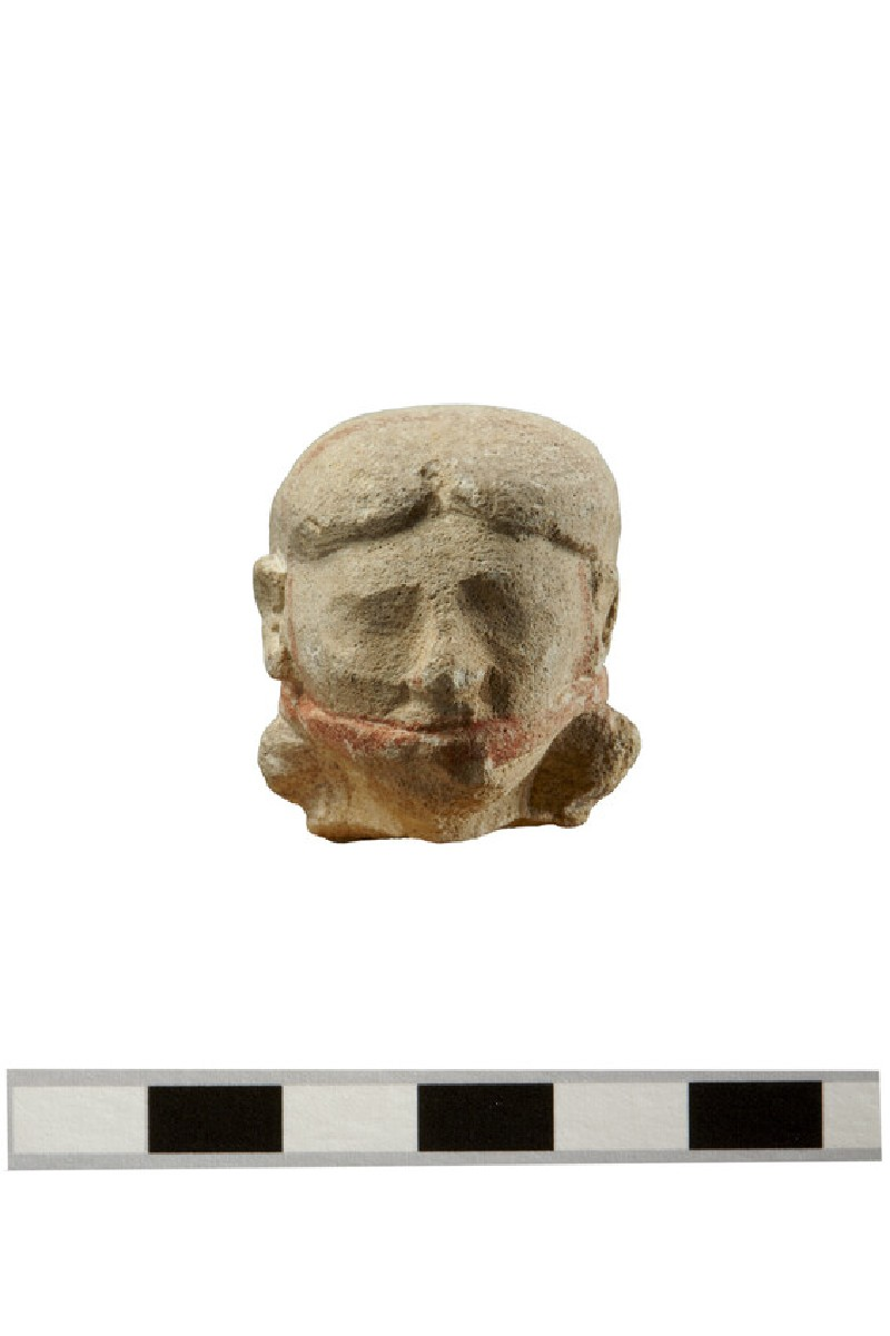 Head of a male double- flute player votive figure in limestone, Egyptianising (AN1891.477)