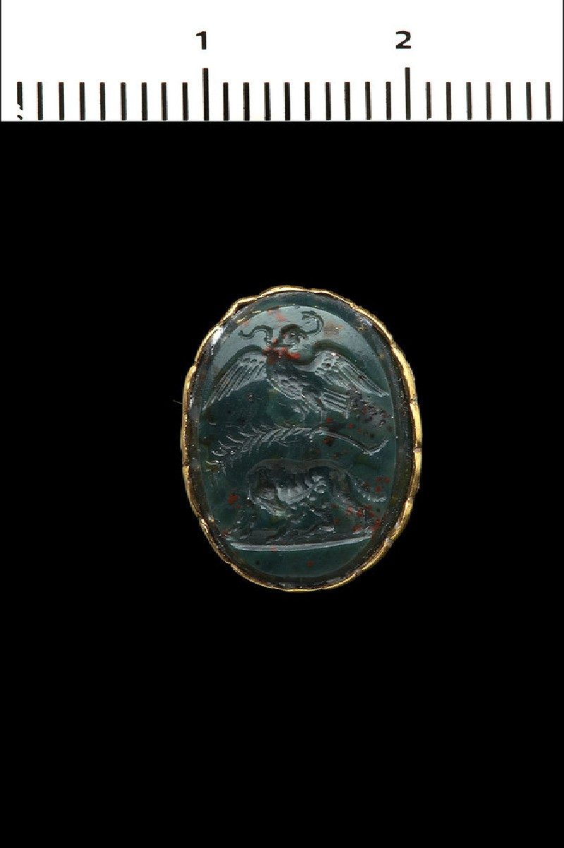 Intaglio gem, an eagle devours a serpent and holds a palm of victory over the Roman wolf, who suckles Romulus and Remus (AN1892.1346)