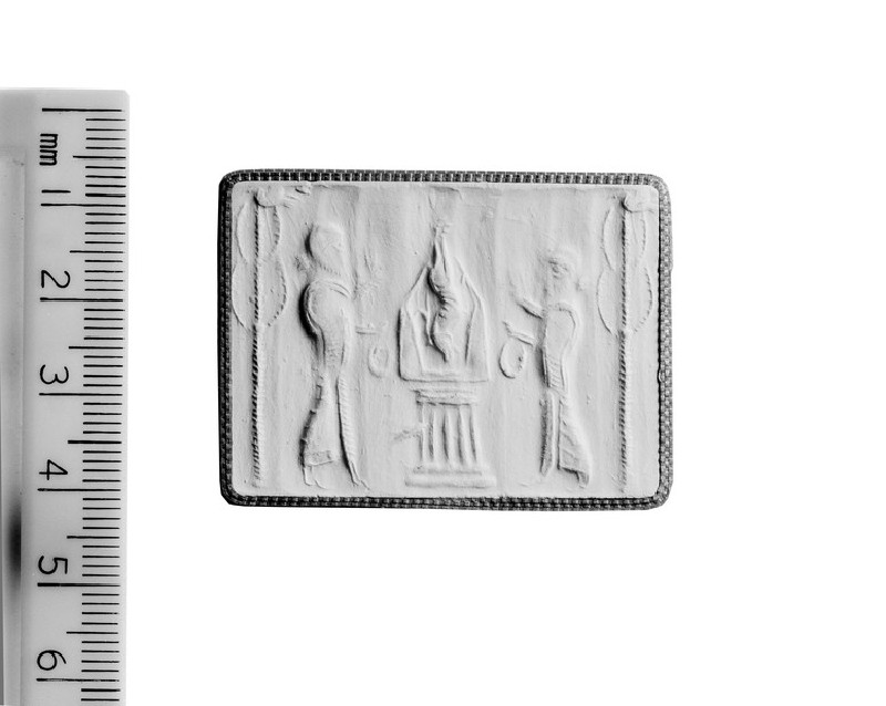 Cylinder seal depicting two priests (AN1892.1416)