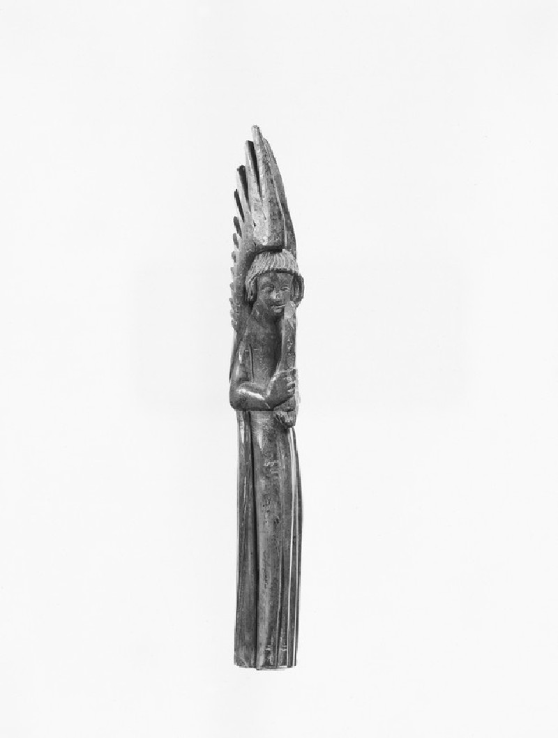 Carving of an angel holding a candelabrum