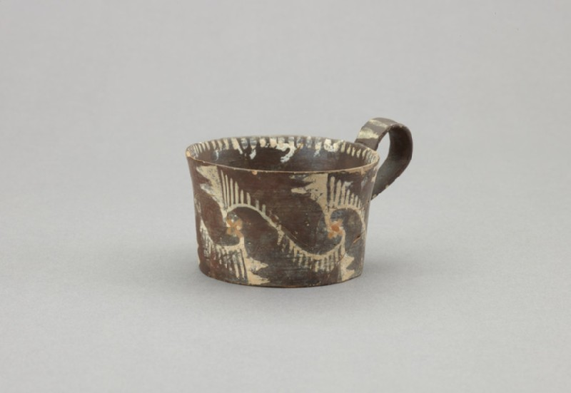 Kamares ware one-handled cup. Decorated with white painted curvilinear designs on black slip (AN1896-1908.AE.934)