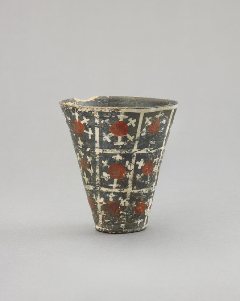Tumbler of Kamares ware, decorated with rosettes within squares