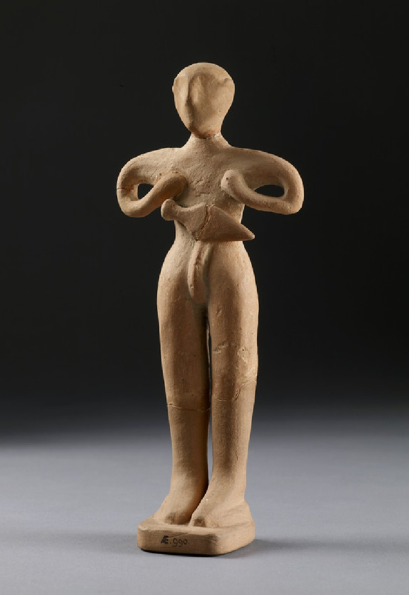 Human figurine, male with dagger