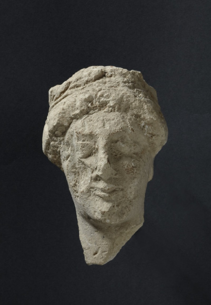 Limestone head of female votary with fillet, votive-statuette (AN1896-1908.C.280)