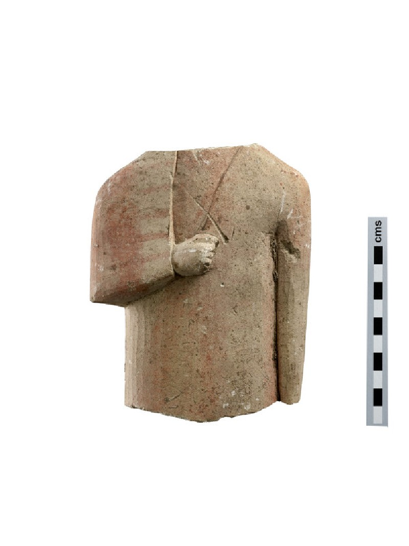 Fragmentary limestone votive statuette: torso of male votary clad in cloak