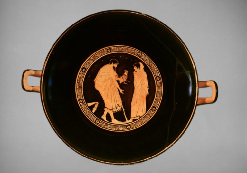 Attic red-figure stemmed pottery cup depicting a courting scene