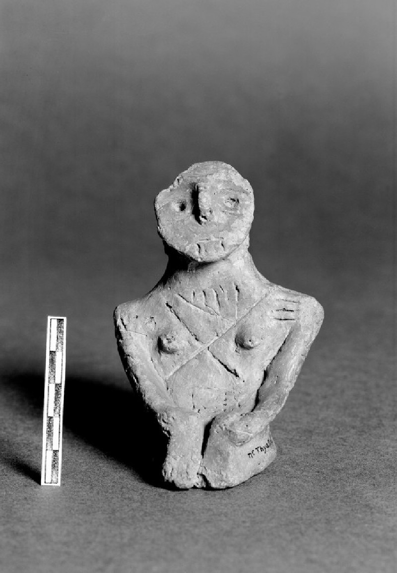 Figurine of nude seated female