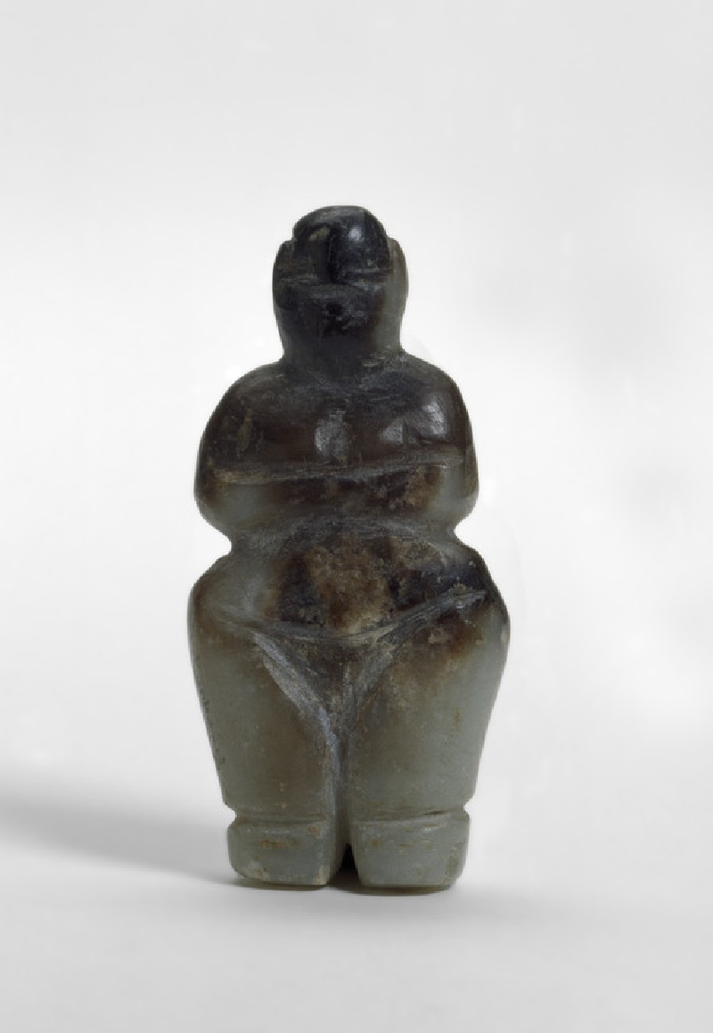 Highly-polished female figurine with hands folded below breasts