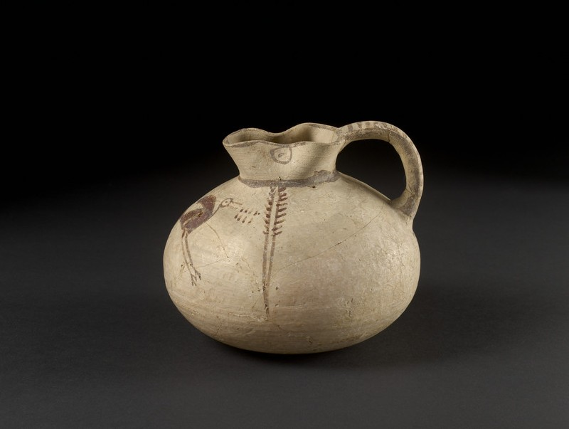 Bichrome sack-shaped juglet decorated in free-field style with a water bird (ibis) and reeds (AN1911.345)