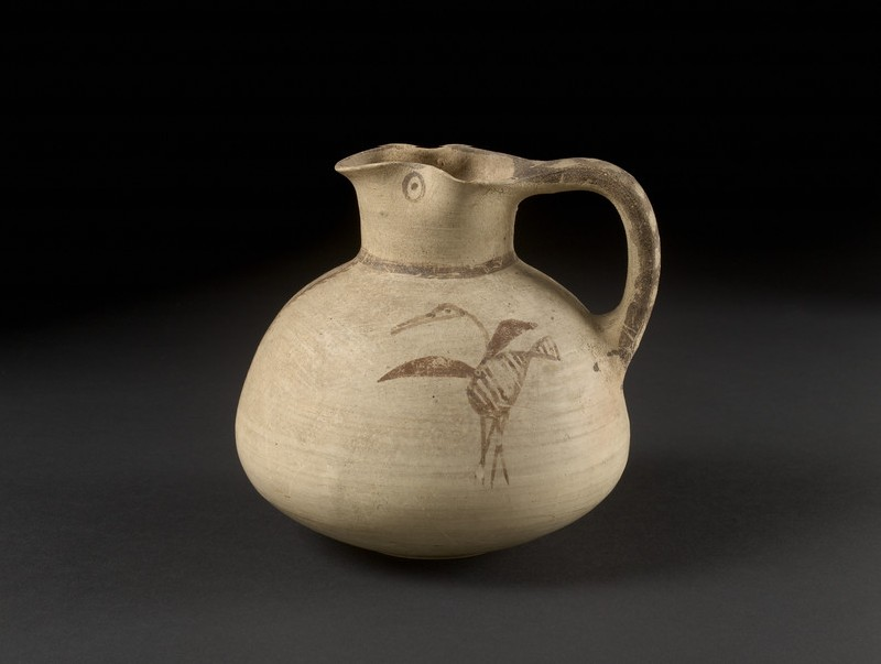 Bichrome Free-Field style sack-shaped juglet with bird (heron or ibis) and plant design, Amathousian style (AN1911.346)
